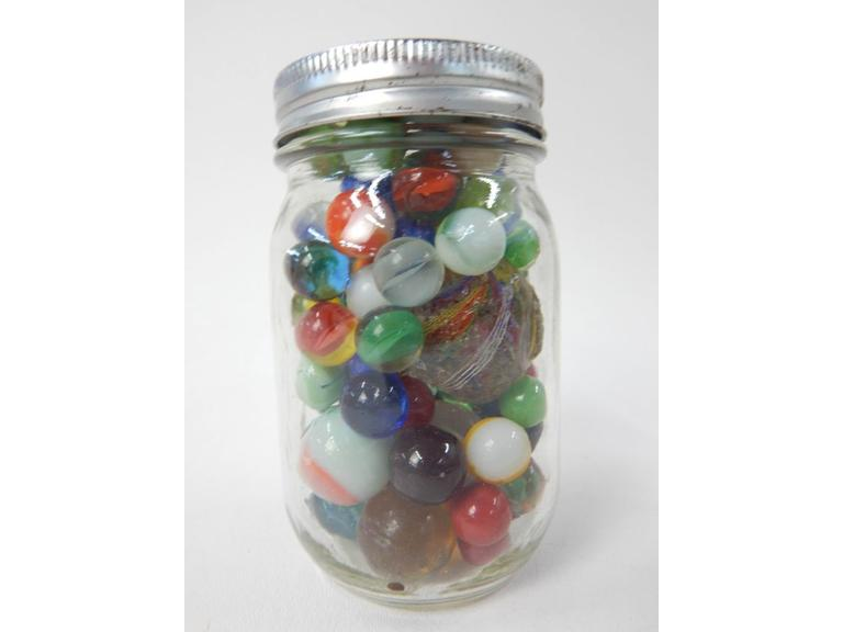 Jar full of Old Glass Marbles