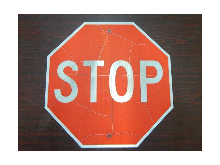 Old Reflective Metal Stop Sign