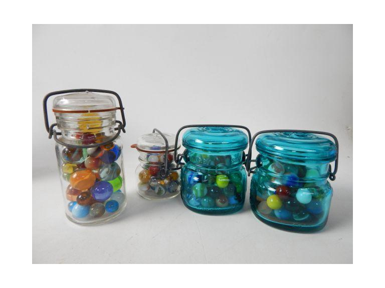 Collection of Small Jars of Marbles