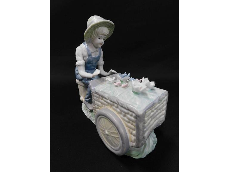 Boy Selling Flowers Figurine