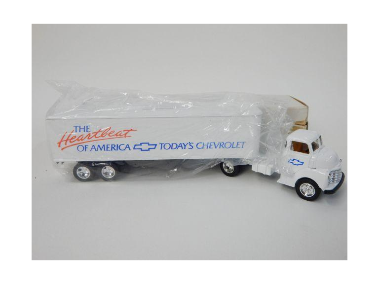 New in the package Ertl Semi Truck Coin Bank