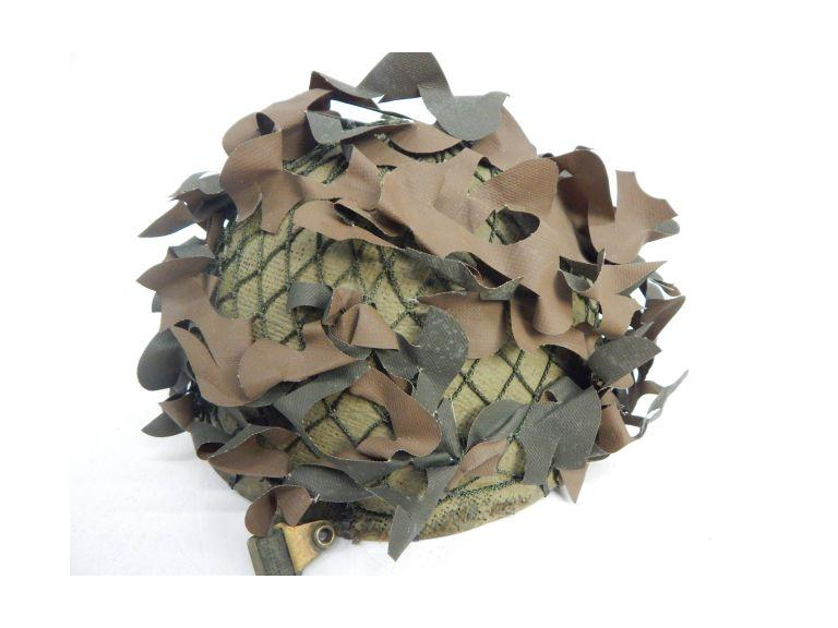 Old Military Helmet with Camo Leaves